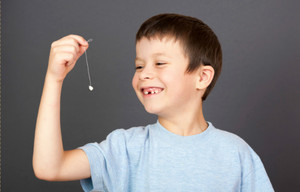 Способ удаления молочного зуба